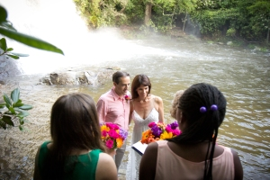 Check out the booming mini-Niagara Falls behind us as we say our vows. Holding on tight to each other so that we don't fall in.