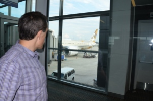 Husband like a little boy so excited to see the plane we will fly on. He'd worked on making this trip happen for the last 10 months.